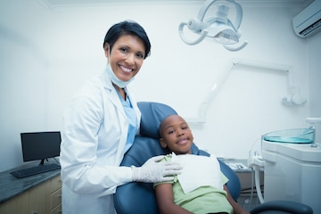 Dentist Smiling with Patient